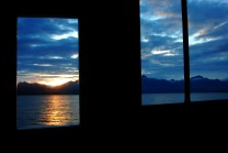 Watching sunrise from inside the Motor Vessel David B's pilothouse