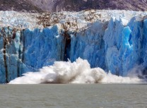The several story high splash of an iceberg calving inti the water