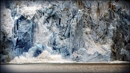 Ice calving from a glacier on an alaska small ship cruise