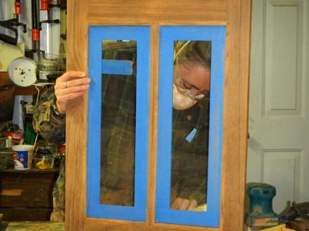 Sanding the David B's galley windows